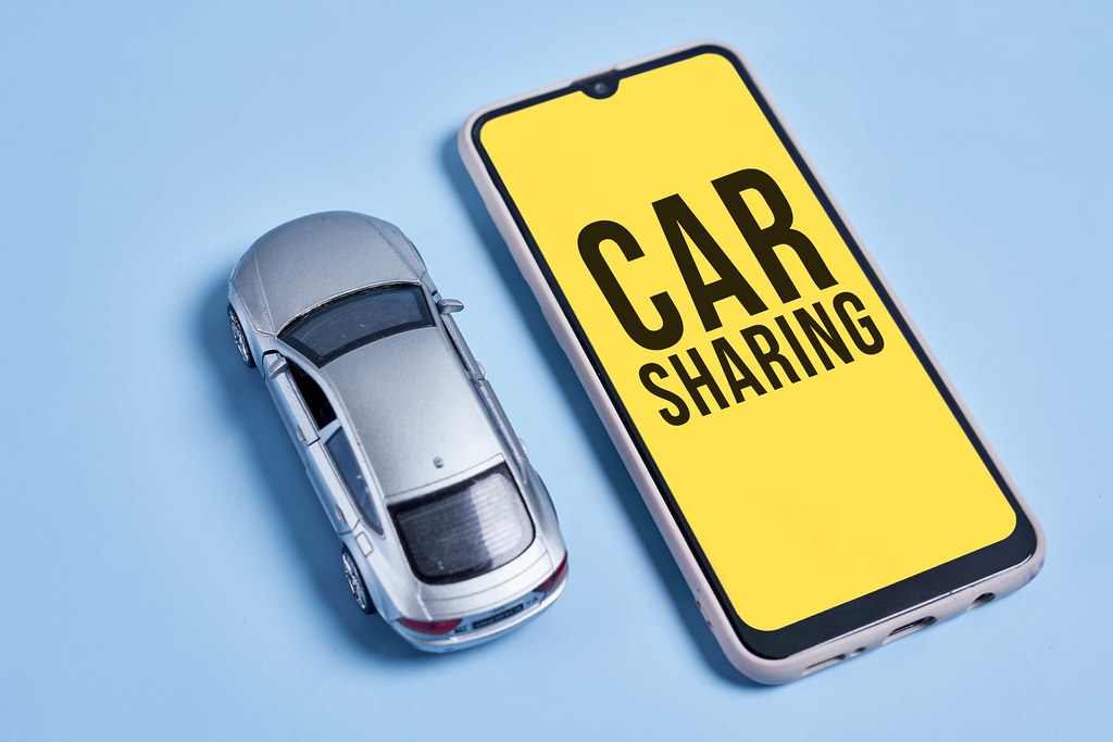 Car sharing concept with car and mobile application
