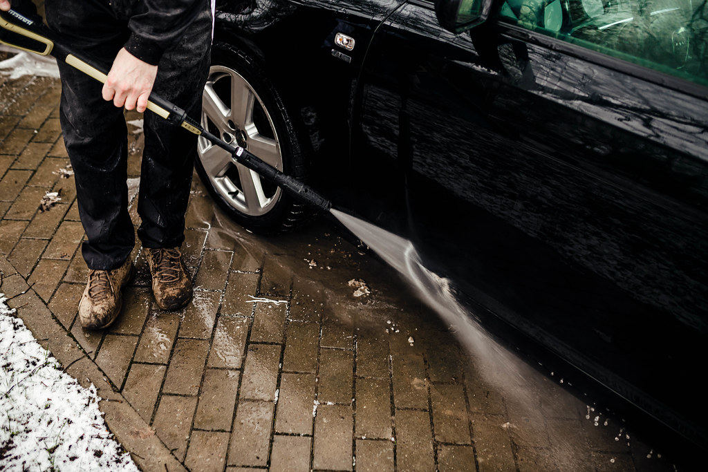 Car Washer Men Holding Karcher Cleaning Doors