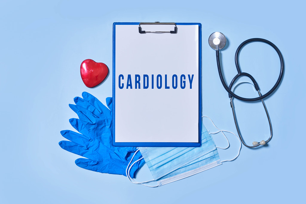 Cardiology - cardiologist tools kit on blue background