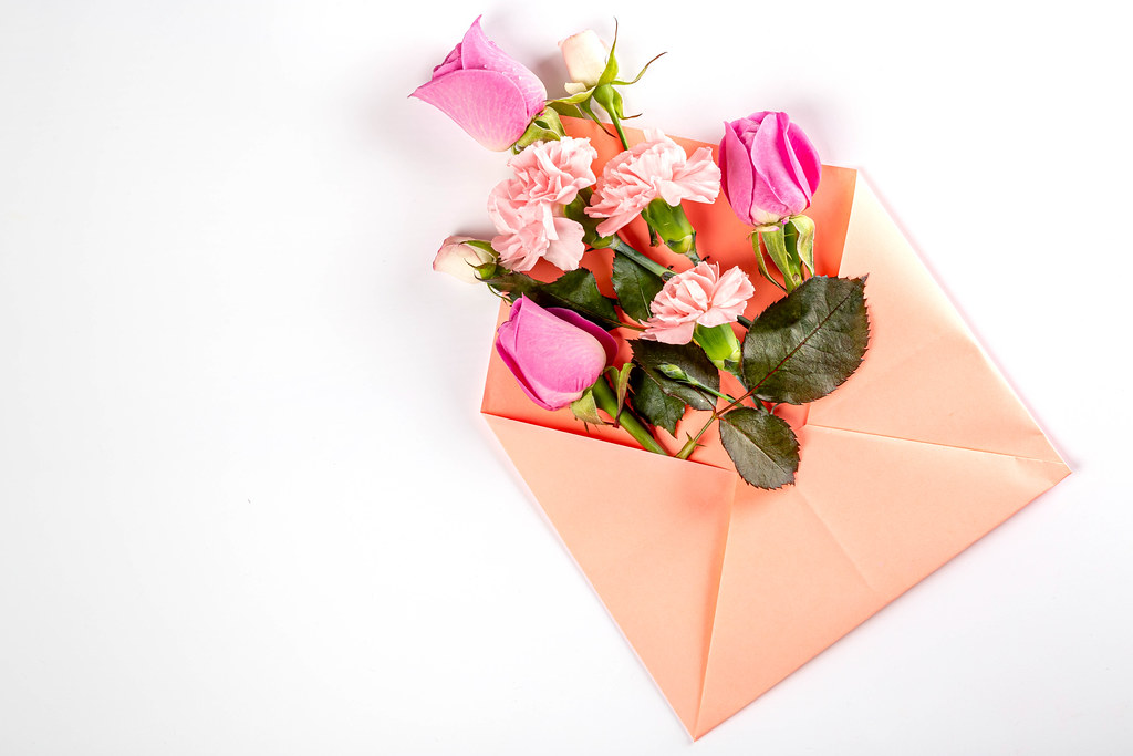 Carnations and roses with pink envelope