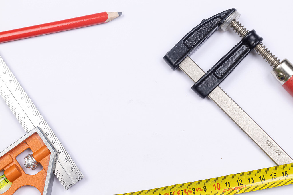 Carpenter Tools above white background with copy space