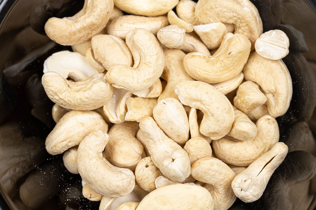Cashew nuts in the black bowl