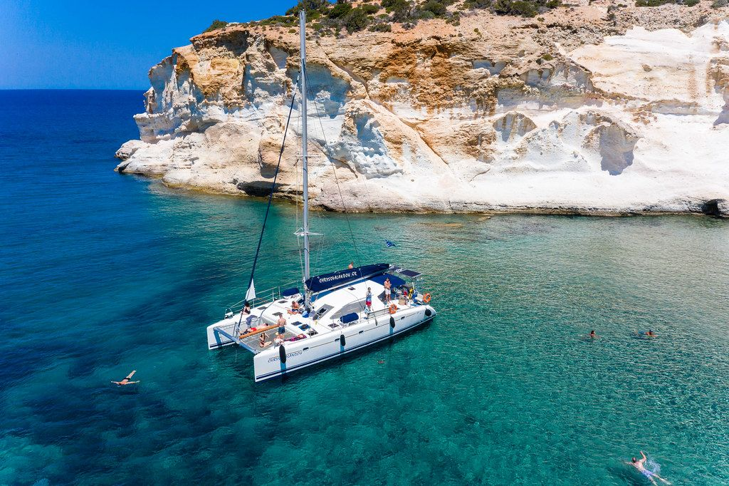 Catamaran tour on the stunning west coast of Milos, where many beaches can only be reached by boat
