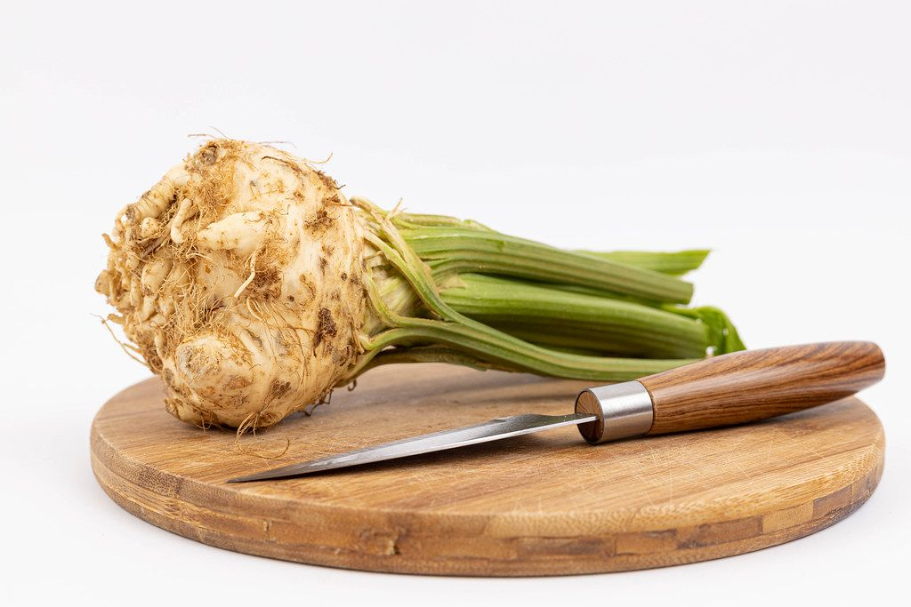 Celery Root on the wooden board with knife