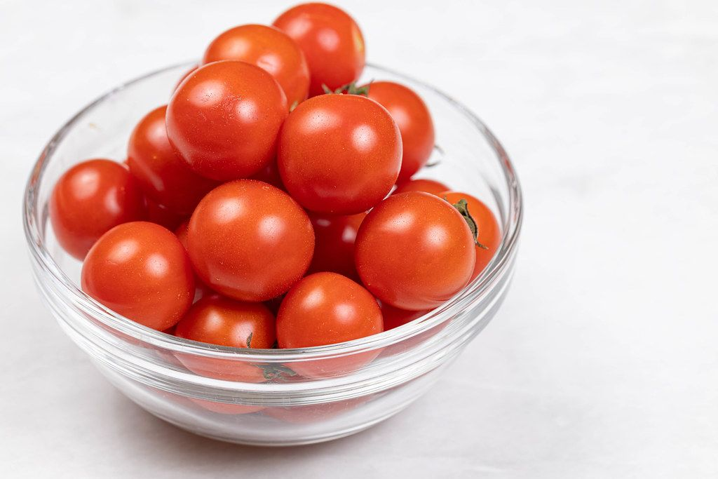 Cherry Tomatoes served in the glass bowl