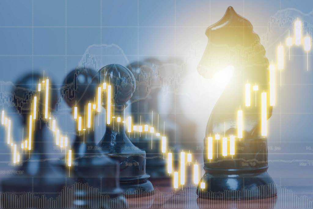 Chess game and stock market or forex trading graphs charts for financial investment concept
