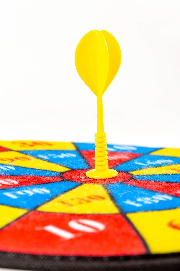 Children's multi-colored dart game with a yellow dart in the center