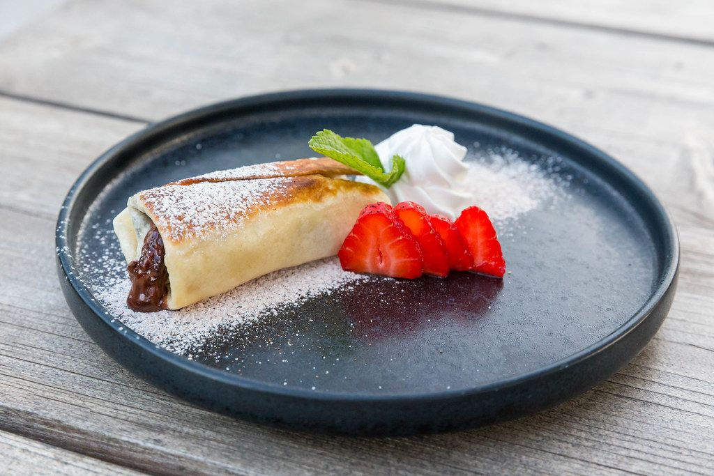 Chimichanga: fried tortilla filled with chocolate and strawberry. Vegan Mexican dessert at Villa Vegana