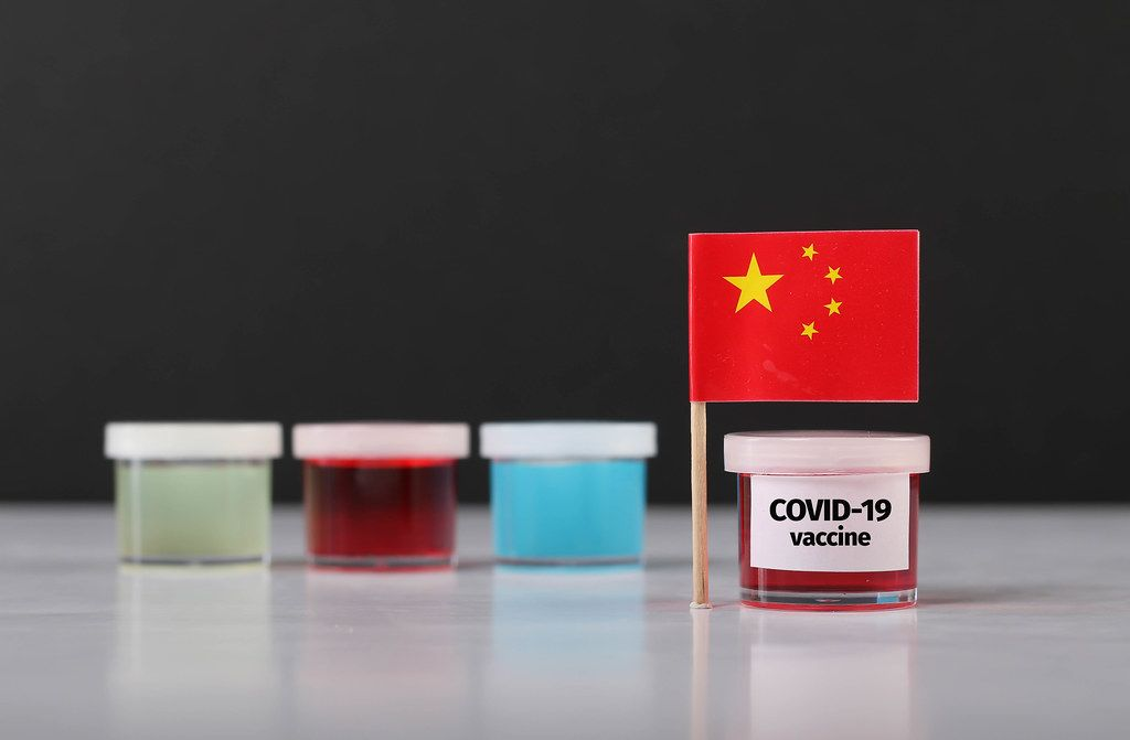 Chinese flag with Covid-19 vaccine
