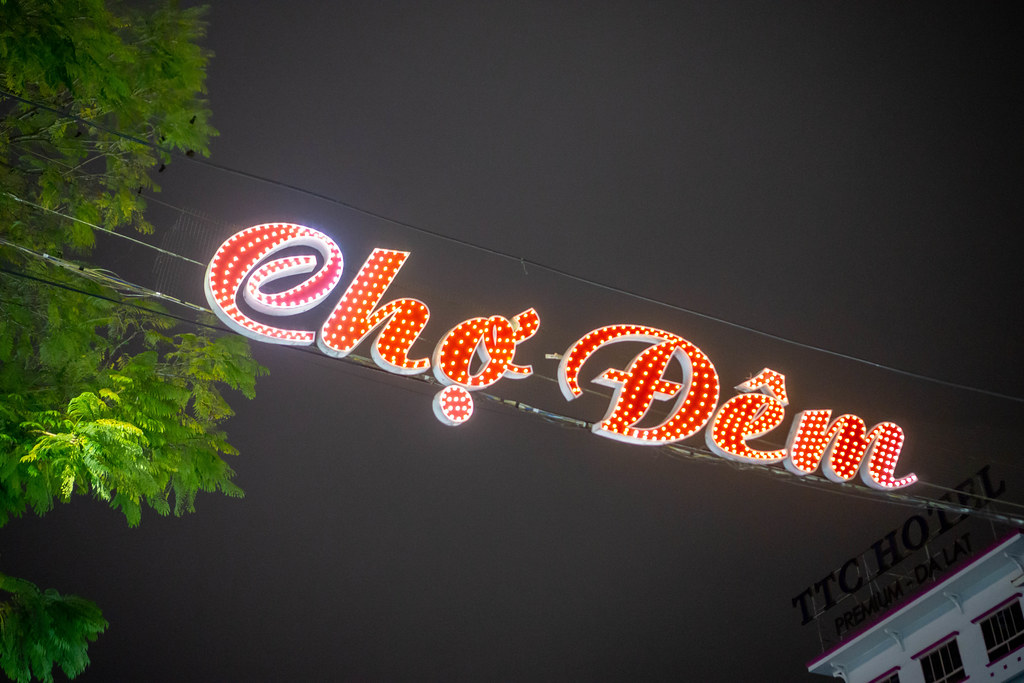 Cho Dem Night Market LED Sign Board hanging on Electric Wires at the Entrance of Dalat Street Night Market in Da Lat, Vietnam