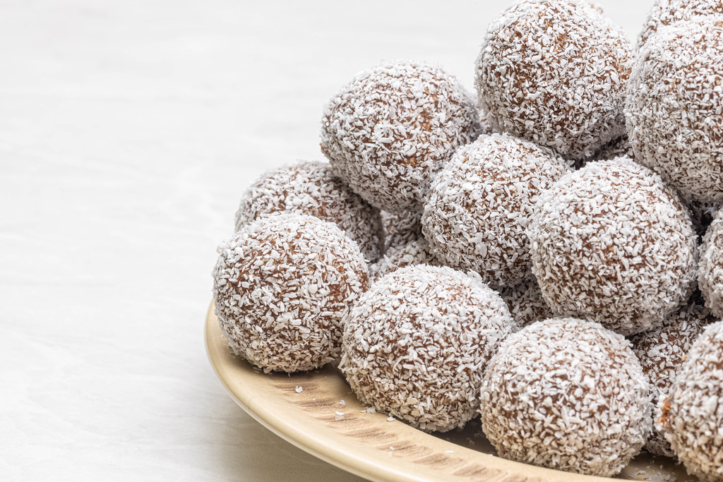 Chocolate Balls with Coconut on the plate with copy space