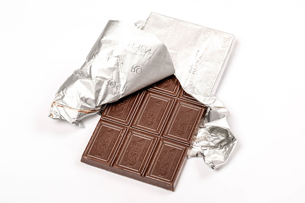 Chocolate bar with foil on white