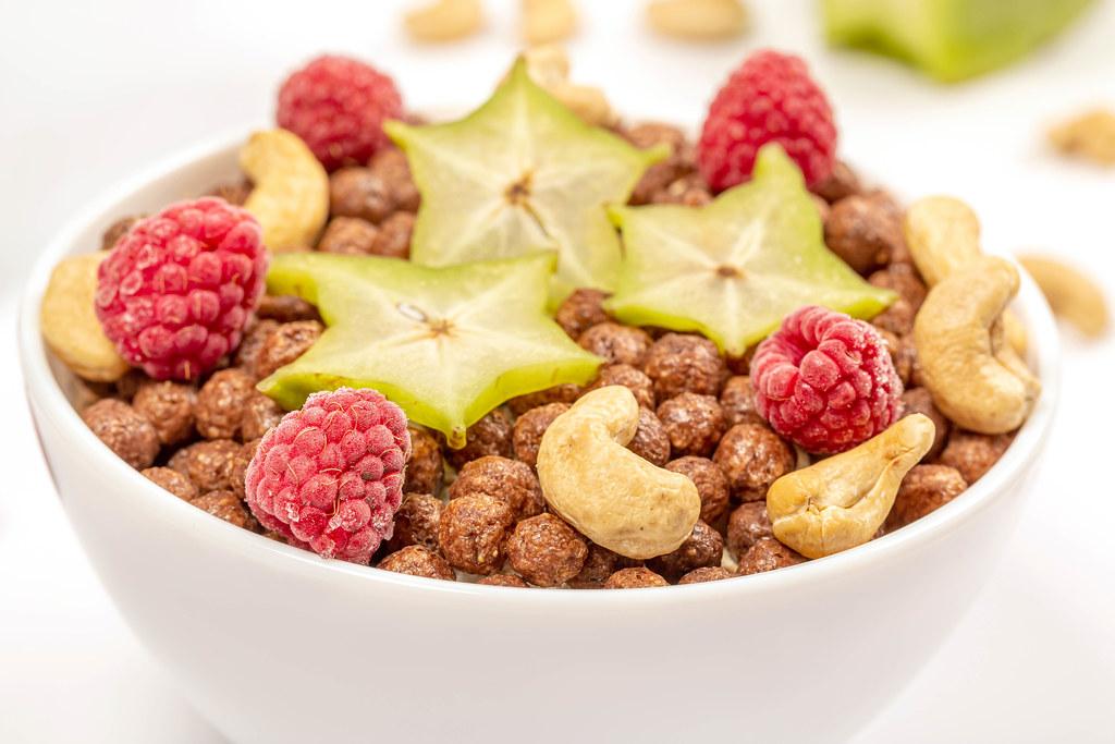 Chocolate corn balls with cashews, raspberries and starfruit, close-up