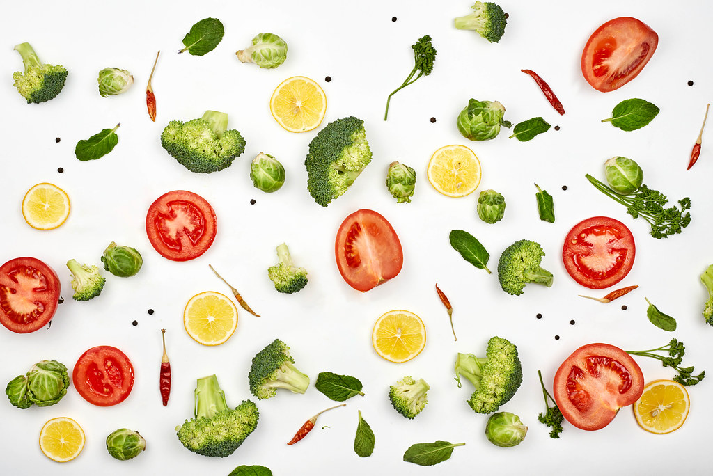 Chopped raw vegetables and fruits background