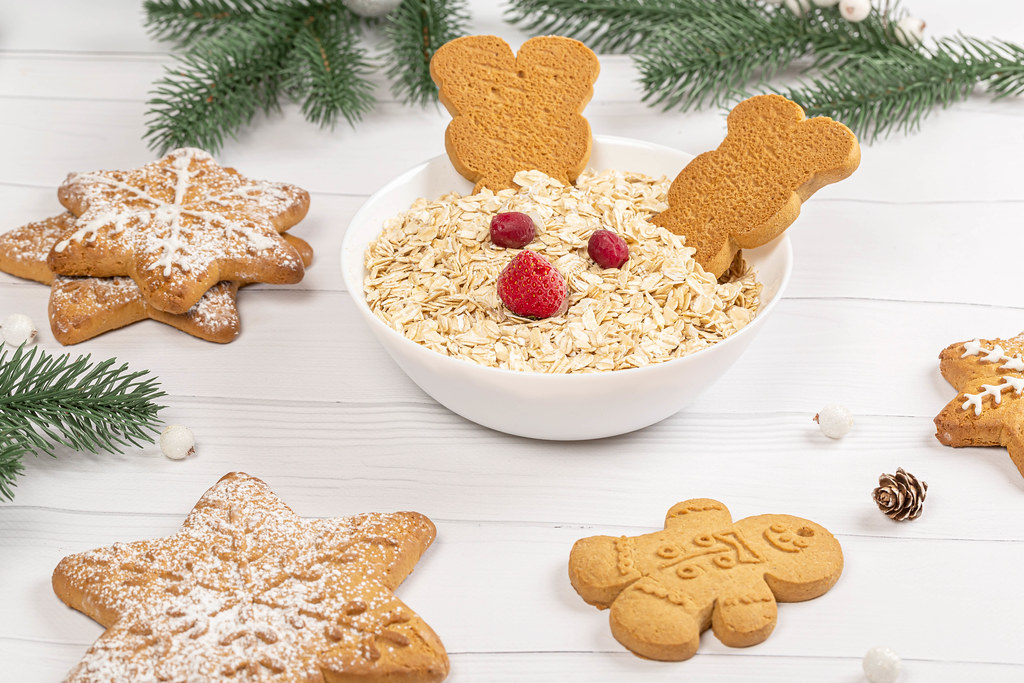 Christmas concept, oatmeal with gingerbread and christmas tree branches