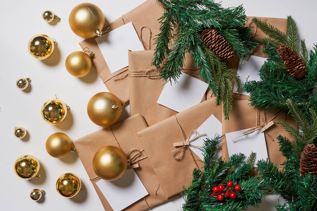 Christmas decorative toys and giftboxes on white
