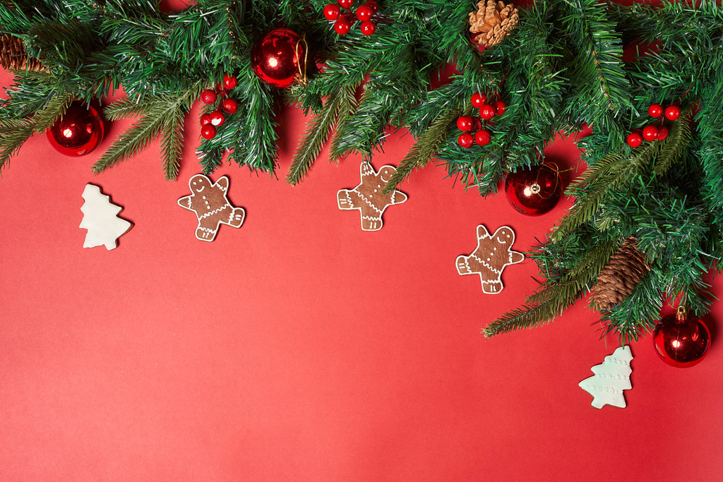 Christmas festive background with decorated Christmas tree branches and baubles