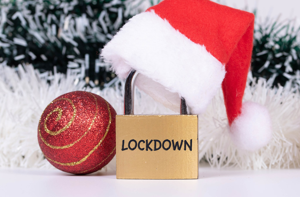 Christmas ornaments and padlock with Christmas hat and Lockdown text