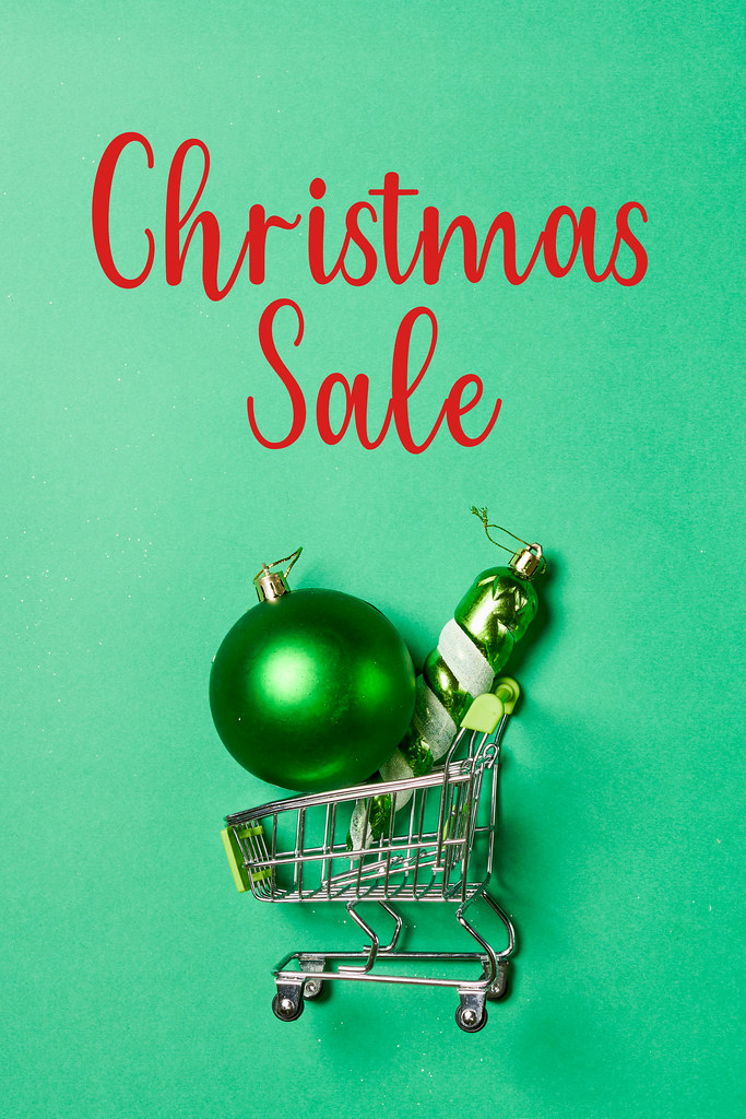 Christmas sale - xmas decorations in shopping trolley