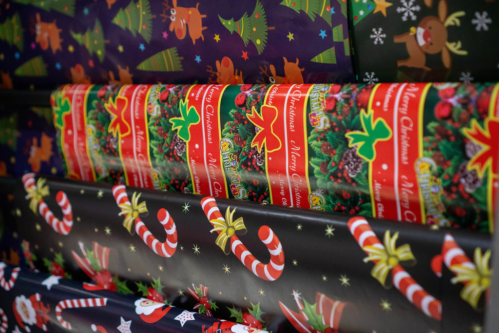 Christmas Themed Wrapping Paper for Gifts with Sugar Canes, Christmas Stars and other Designs