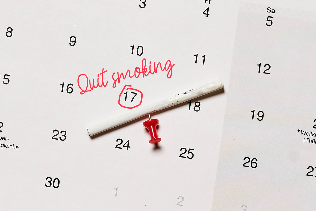 Cigarette and calendar with the marked date of quit smoking