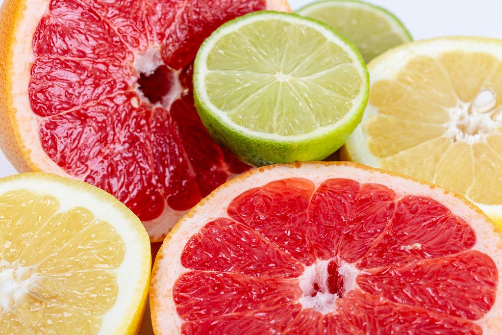 Citrus food background with fresh fruit halves