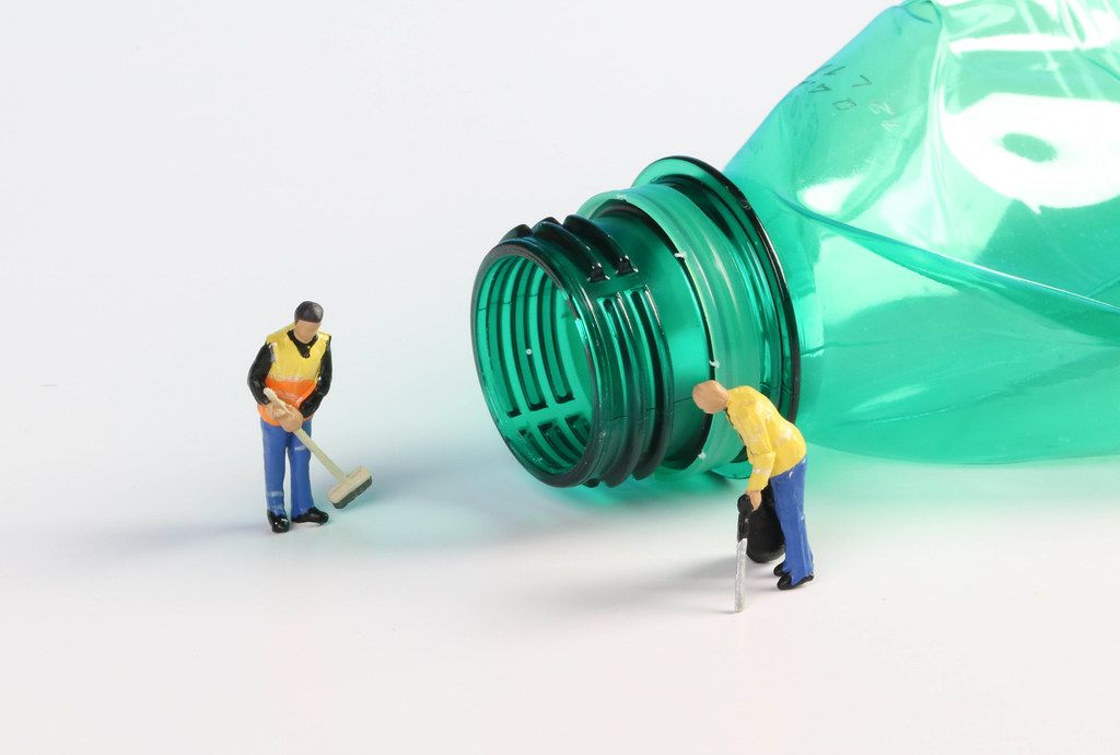 Cleaning workers with empty plastic bottle