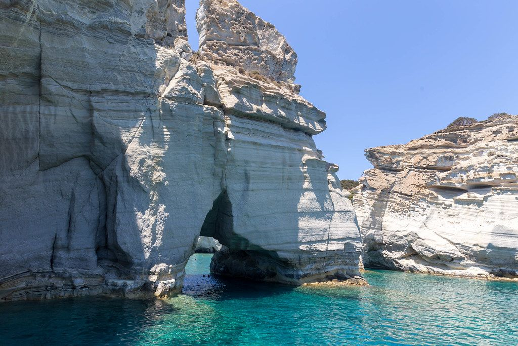Cliffs, natural arch and crystal-clear waters in the South Aegean. The island of Milos in Greece