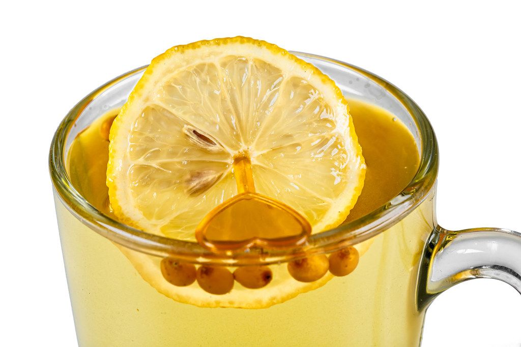 Close-up, a cup of sea buckthorn tea with a slice of lemon