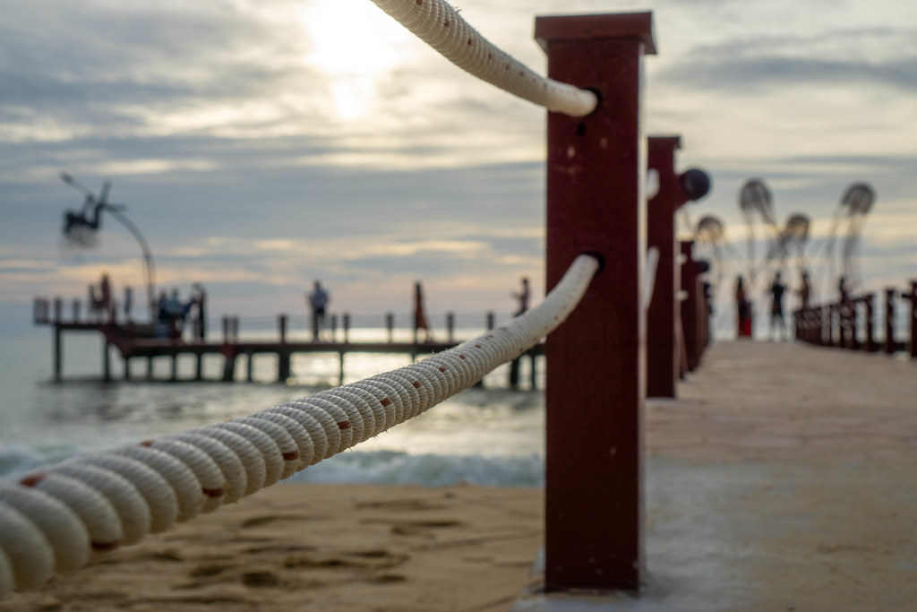 Close Up Bokeh Photo of Rope from a Footbridge leading to Photo Spots on the Sea at Sunset Sanato Beach Club in Phu Quoc, Vietnam