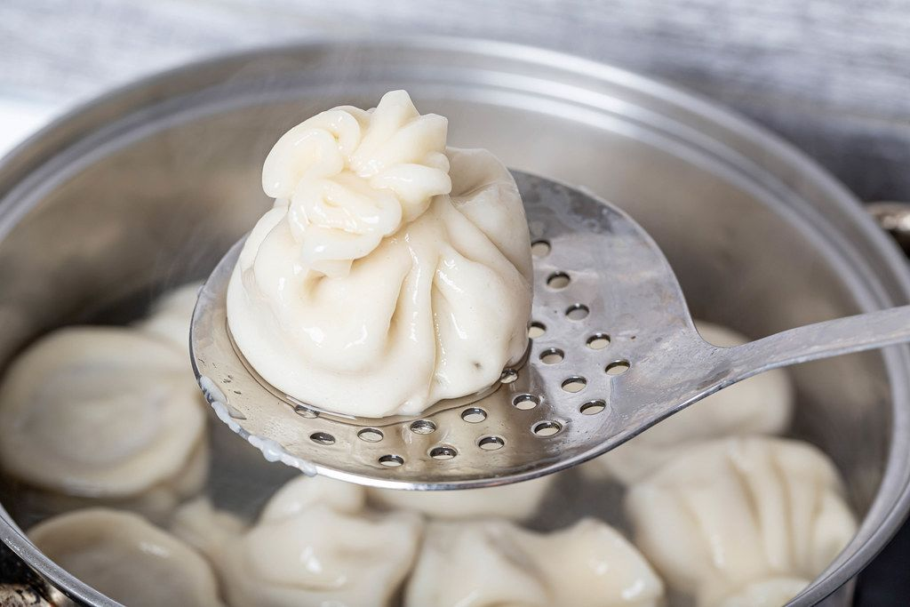 Close-up, cooked khinkali on a skimmer