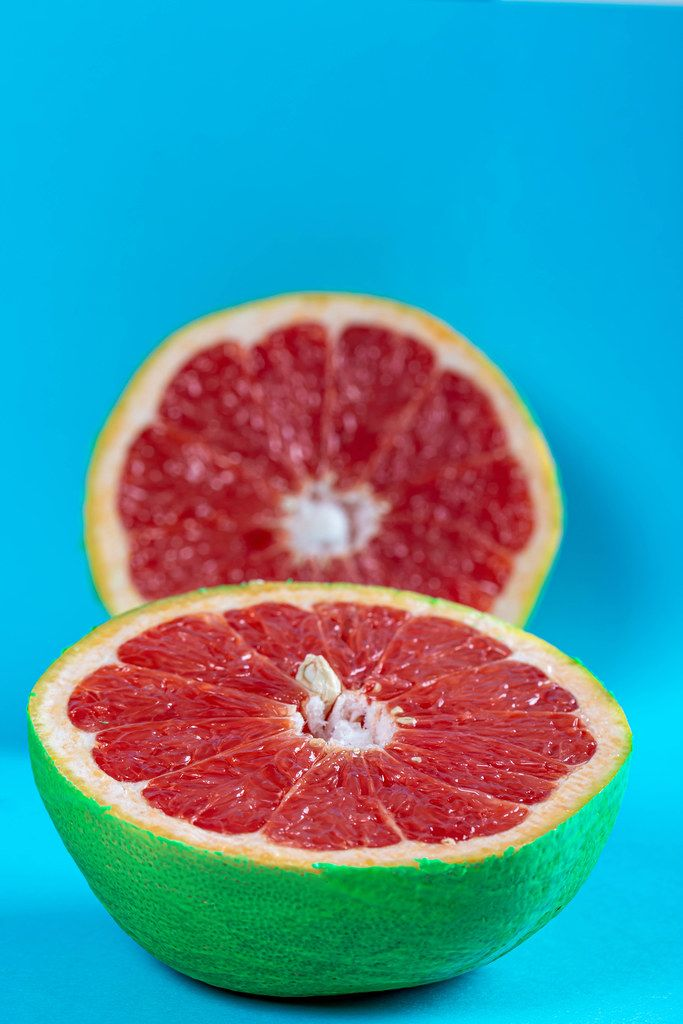 Close-up cut ripe grapefruit on blue