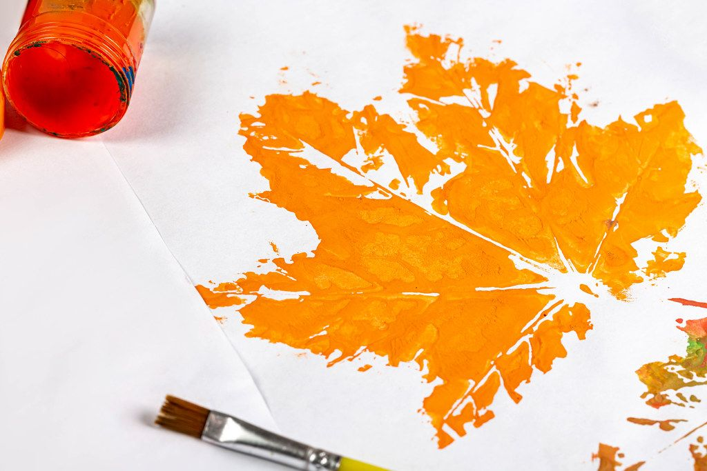 Close-up drawing of an orange maple leaf