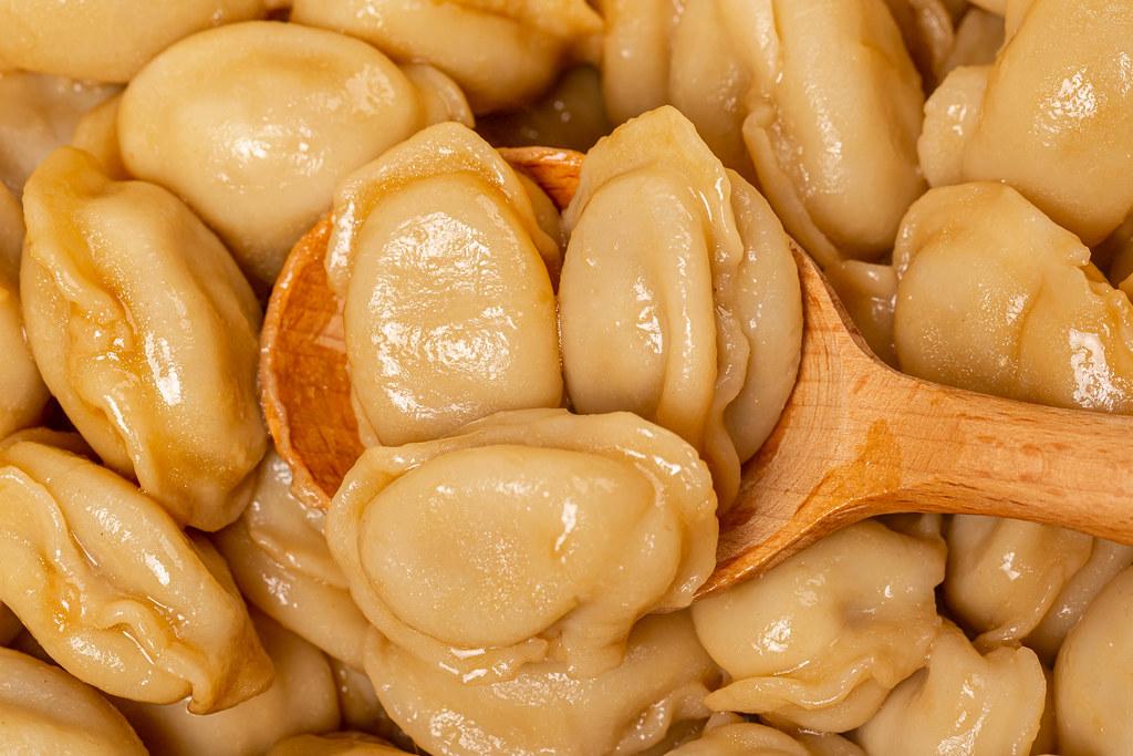 Close-up, dumplings in a wooden spoon