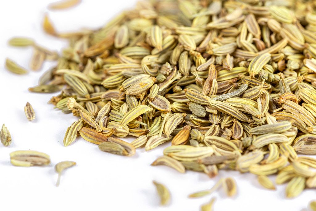 Close-up, fennel seeds on a white background
