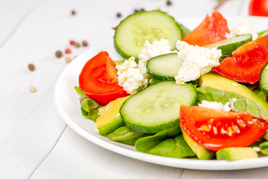 Close-up, fresh vegetable salad with cottage cheese