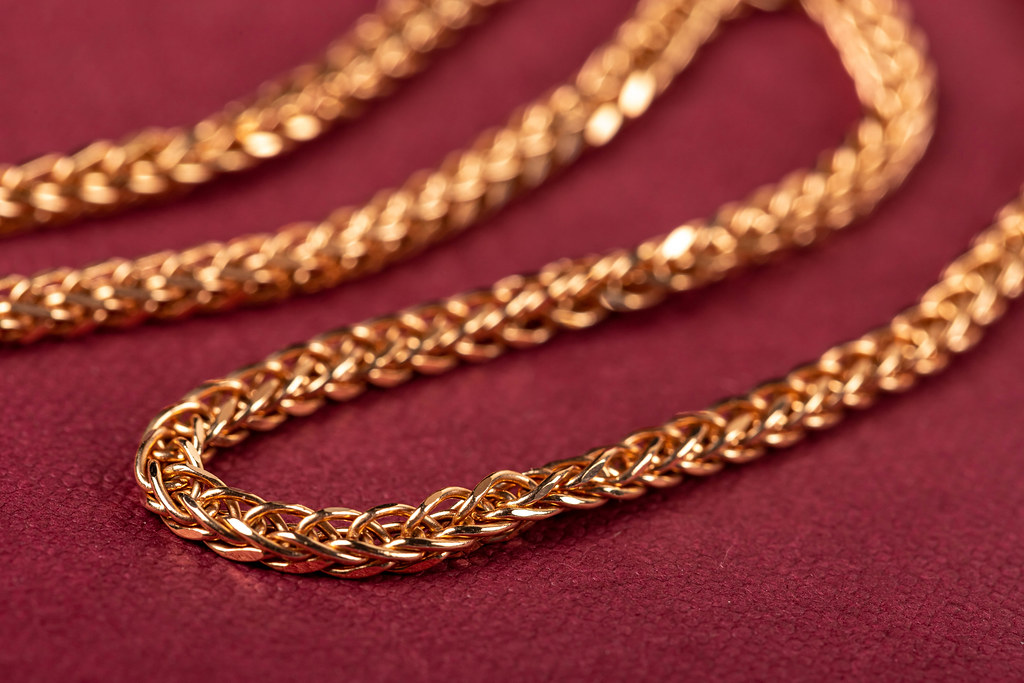 Close up, golden chain weaving anchor