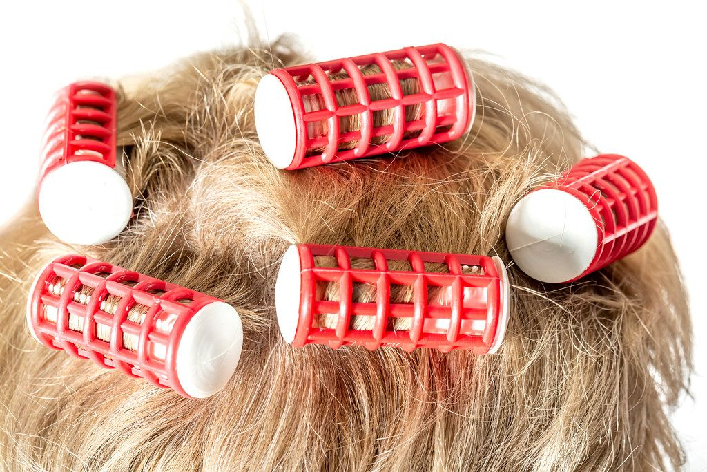 Close-up hair curlers on blond female hair