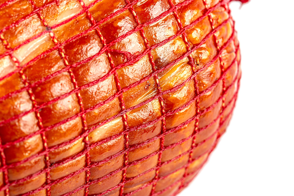 Close-up, ham sealed in a net