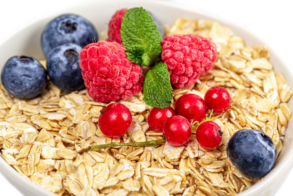 Close-up, oatmeal with berries and fresh mint