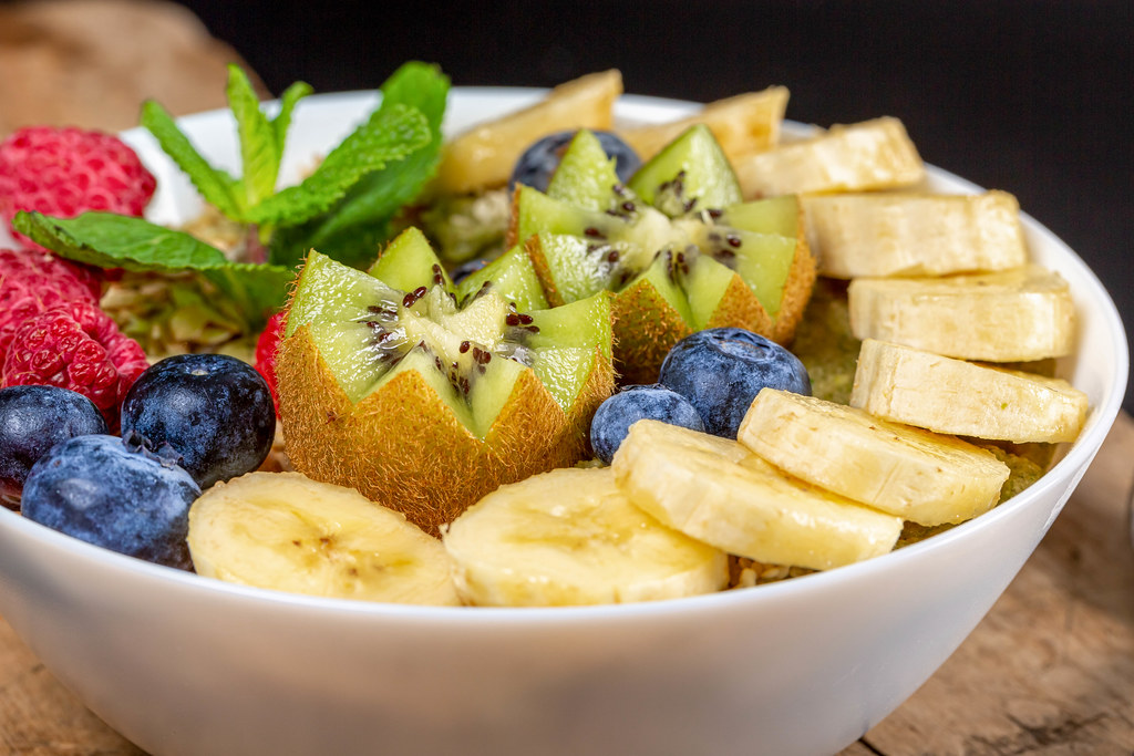 Close-up, oatmeal with berries, banana and kiwi