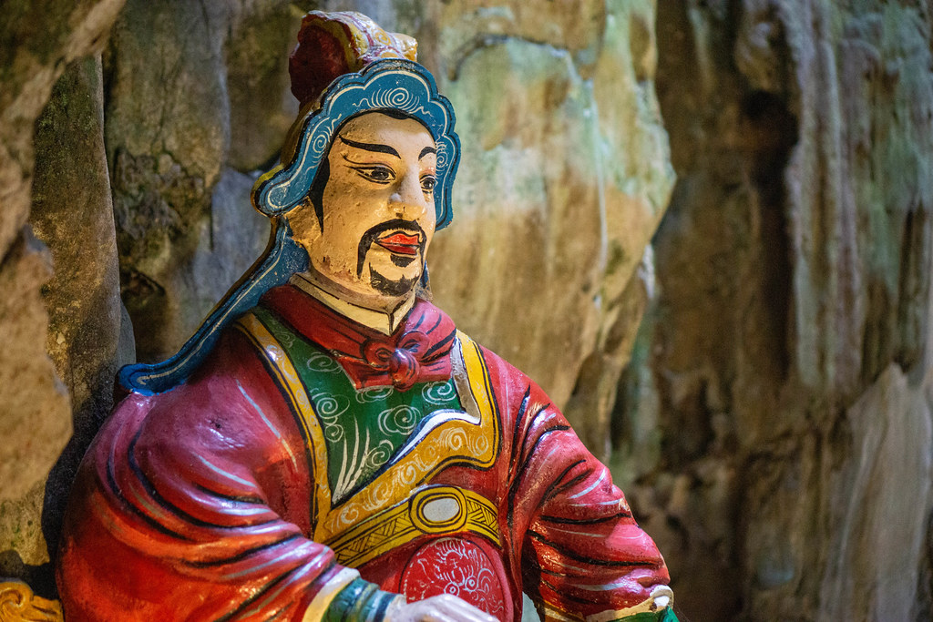 Close Up of a Painted Statue of the God of the Gate at the Entrance of a Cave at Marble Mountains in Da Nang, Vietnam