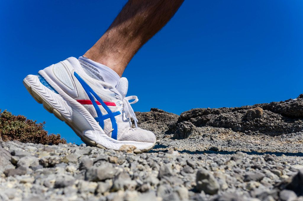 Close-up of an Asics running shoe for men. Active holiday in Greece, running on stones