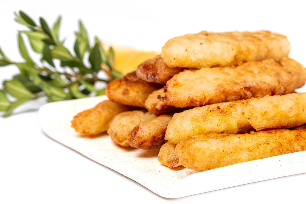 Close-up of fried fish sticks in crispy breading