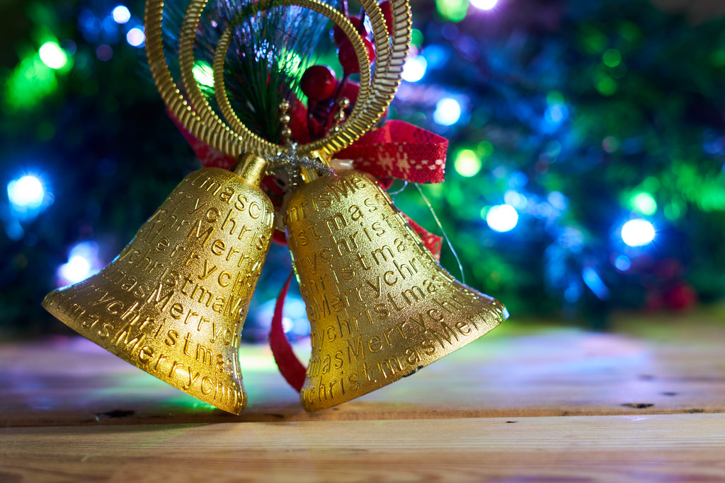 Close up of golden Christmas ornament against Xmas tree