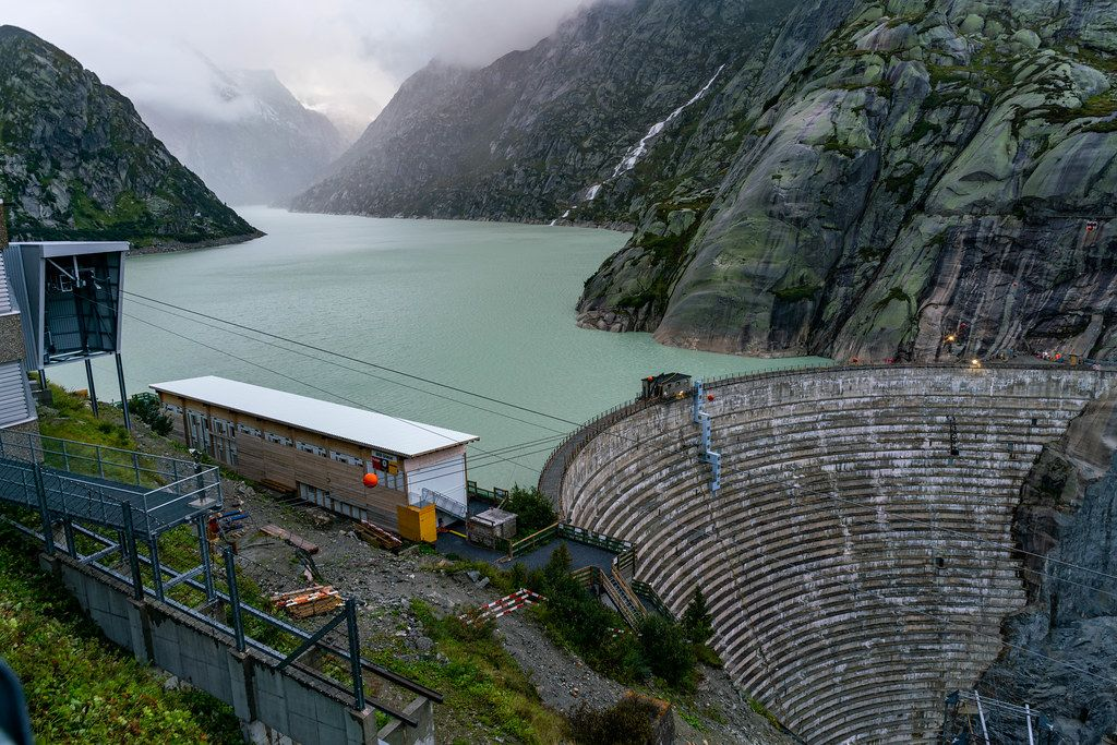 Close up of Grimsel Pass dam and mountain lake behind it