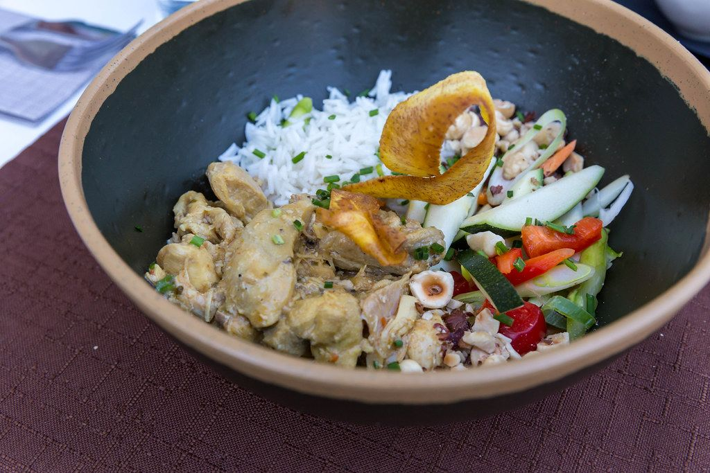Close-up of revisitation of country chicken curry dish with rice and veggies by Q11 restaurant in Pollença