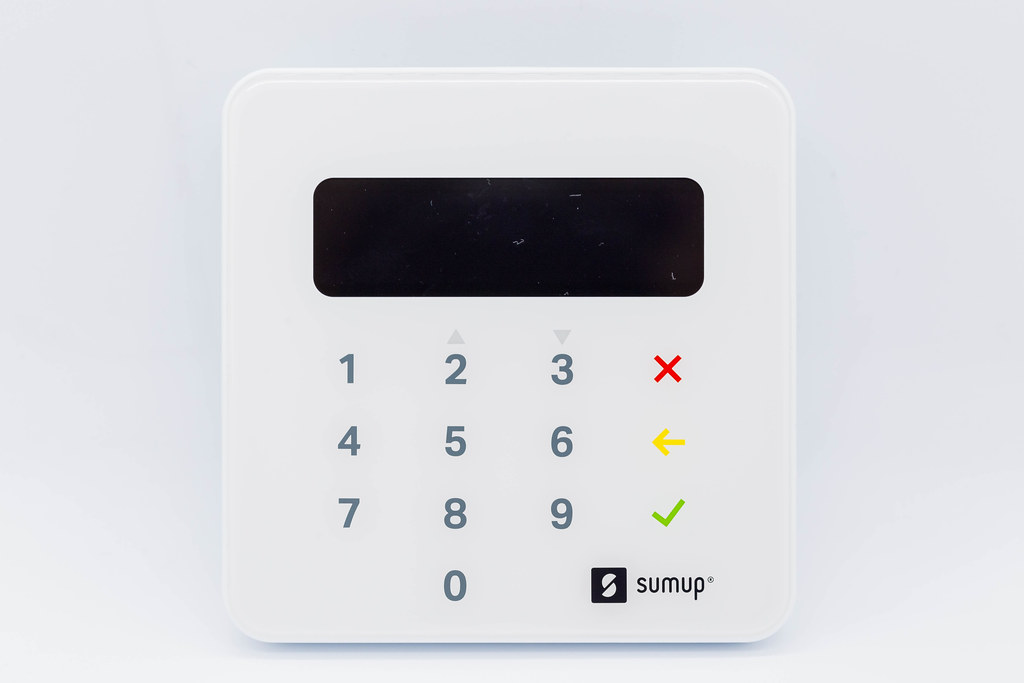 Close-up of SumUp Air card reader for contactless and chip payments against white background