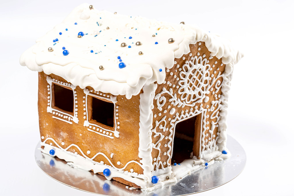 Close-up of the gingerbread house on white