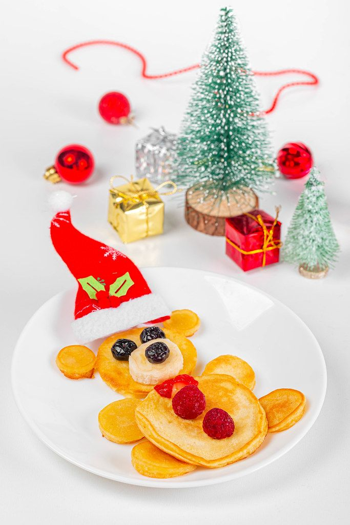 Close-up, pancakes bear with berries, new year gifts and christmas tree